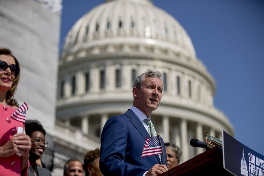 Rep. Matt Cartwright, D-Penn., right, accompanied by House Speaker Nancy Pelosi of Calif., left, and other House Democrats, speaks during a news conference on the first 200 days of the 116th Congress at the House East Front Steps of the Capitol building, in Washington, Thursday, July 25, 2019. (AP Photo/Andrew Harnik)