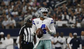 Dallas Cowboys quarterback Dak Prescott (4) drops back to pass in the second half of a NFL football game against the New York Giants in Arlington, Texas, Sunday, Sept. 8, 2019. (AP Photo/Michael Ainsworth)