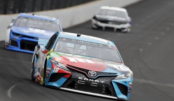 Kyle Busch drives into turn one during the NASCAR Brickyard 400 auto race at Indianapolis Motor Speedway, Sunday, Sept. 8, 2019, in Indianapolis. (AP Photo/Darron Cummings)