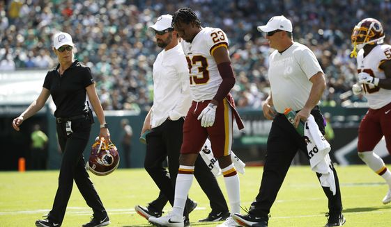Washington Redskins' Quinton Dunbar walks off the field after an injury during the second half of an NFL football game against the Philadelphia Eagles, Sunday, Sept. 8, 2019, in Philadelphia. (AP Photo/Matt Rourke)