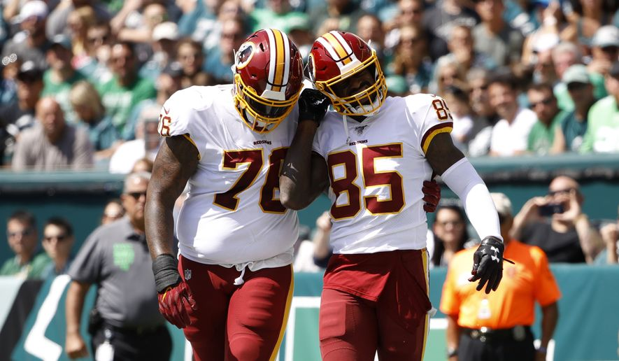Washington Redskins' Vernon Davis, right, and Morgan Moses celebrate after Davis' touchdown during the first half of an NFL football game against the Philadelphia Eagles, Sunday, Sept. 8, 2019, in Philadelphia. (AP Photo/Matt Rourke) ** FILE **