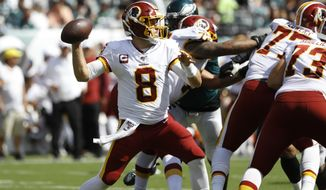 Washington Redskins' Case Keenum in action during the first half of an NFL football game against the Philadelphia Eagles, Sunday, Sept. 8, 2019, in Philadelphia. (AP Photo/Michael Perez)