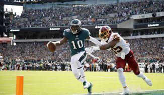 Philadelphia Eagles' DeSean Jackson, left, scores a touchdown against Washington Redskins' Montae Nicholson during the second half of an NFL football game, Sunday, Sept. 8, 2019, in Philadelphia. (AP Photo/Matt Rourke)