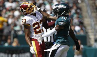Washington Redskins' Quinton Dunbar, left, and Philadelphia Eagles' DeSean Jackson scuffle during the first half of an NFL football game, Sunday, Sept. 8, 2019, in Philadelphia. (AP Photo/Matt Rourke)