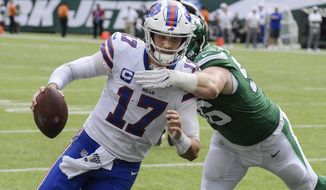 Buffalo Bills' Josh Allen (17) runs past New York Jets' Henry Anderson (96) for a touchdown during the second half of an NFL football game Sunday, Sept. 8, 2019, in East Rutherford, N.J. (AP Photo/Bill Kostroun)