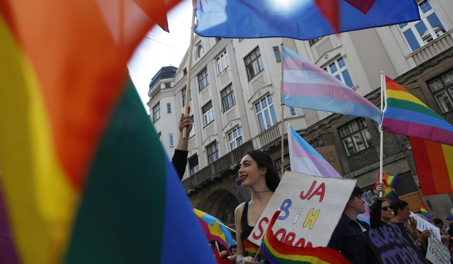Participant blows a whistle during the country's first ever LGBT pride parade in downtown Sarajevo, Bosnia-Herzegovina, Sunday, Sept. 8, 2019. Sarajevo is the last capital city in the Balkans to hold a pride parade after neighboring countries moved to improve LGBT rights. (AP Photo/Darko Bandic)