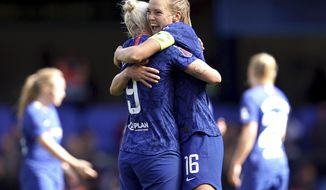 Chelsea's Bethany England, left, celebrates scoring against Tottenham Hotspur with teammate Magdalena Eriksson during the Women's Super League soccer match at Stamford Bridge, London, Sunday Sept. 8, 2019. (John Walton/PA via AP)