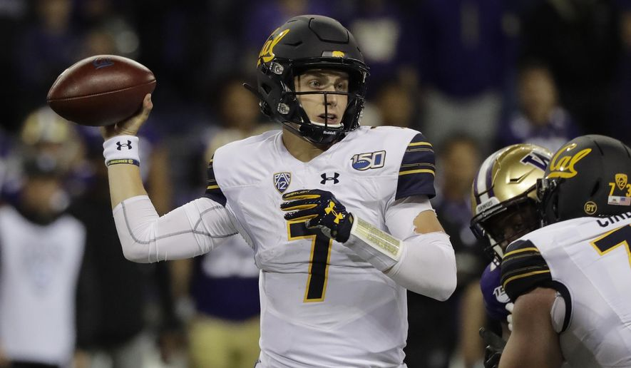 California quarterback Chase Garbers passes against Washington during the first half of an NCAA college football game, Saturday, Sept. 7, 2019, in Seattle. (AP Photo/Ted S. Warren)