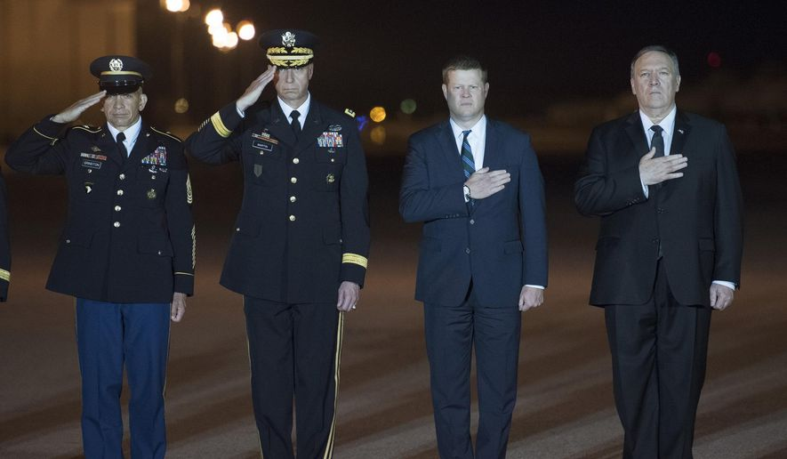 Sergeant Major of the Army Michael Grinston, left, Army Gen. Joseph Martin, vice chief of staff, center left, Ryan McCarthy, Acting Secretary of the Army, center right, and Secretary of State Mike Pompeo, right, participate in the Dignified Return for Sgt. 1st Class Elis Barreto Ortiz, 34, from Morovis, Puerto Rico, Saturday, Sept. 7, 2019, at Dover Air Force Base, Del. According to the Department of Defense, Ortiz was killed in action Sept. 5, when a vehicle-borne improvised explosive device detonated near his vehicle in Kabul, Afghanistan. Ortiz was supporting Operation Freedom's Sentinel. (AP Photo/Cliff Owen) ** FILE **