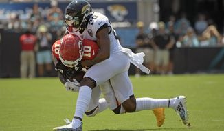 Kansas City Chiefs wide receiver Tyreek Hill (10) is stopped by Jacksonville Jaguars cornerback Jalen Ramsey (20) after a reception during the first half of an NFL football game Sunday, Sept. 8, 2019, in Jacksonville, Fla. (AP Photo/Phelan M. Ebenhack)