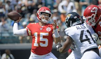 Kansas City Chiefs quarterback Patrick Mahomes (15) throws a pass as he is pressured by Jacksonville Jaguars defensive end Josh Allen during the first half of an NFL football game, Sunday, Sept. 8, 2019, in Jacksonville, Fla. (AP Photo/Phelan M. Ebenhack)