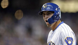 Milwaukee Brewers' Tyrone Taylor reacts after hitting an RBI-single during the sixth inning of a baseball game against the Chicago Cubs Sunday, Sept. 8, 2019, in Milwaukee. It was Taylor's first hit in the majors. (AP Photo/Aaron Gash)