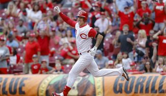 Cincinnati Reds' Michael Lorenzen runs the bases after hitting a game-winning RBI double off Arizona Diamondbacks relief pitcher T.J. McFarland in the ninth inning of a baseball game, Sunday, Sept. 8, 2019, in Cincinnati. (AP Photo/John Minchillo)