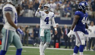 Dallas Cowboys' Dak Prescott (4) celebrates a touchdown as New York Giants linebacker Markus Golden (44) walks away in the first half of a NFL football game in Arlington, Texas, Sunday, Sept. 8, 2019. (AP Photo/Ron Jenkins)