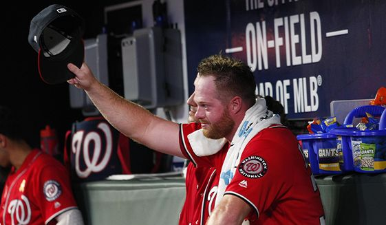 Washington Nationals pitcher Aaron Barrett tips his cap to his teammates after being consoled by them after he pitched his first major league game since 2015, in the fifth inning of a baseball game Saturday, Sept. 7, 2019, in Atlanta. (AP Photo/Tami Chappell) ** FILE **