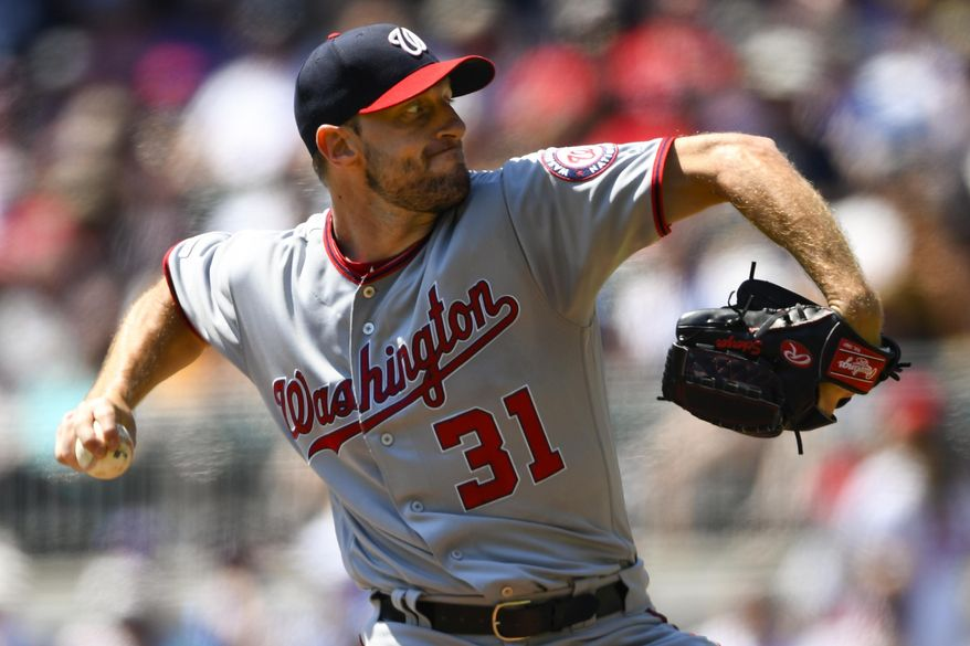 Washington Nationals' Max Scherzer pitches during the first inning of a baseball game against the Atlanta Braves, Sunday, Sept. 8, 2019, in Atlanta. (AP Photo/John Amis) ** FILE **