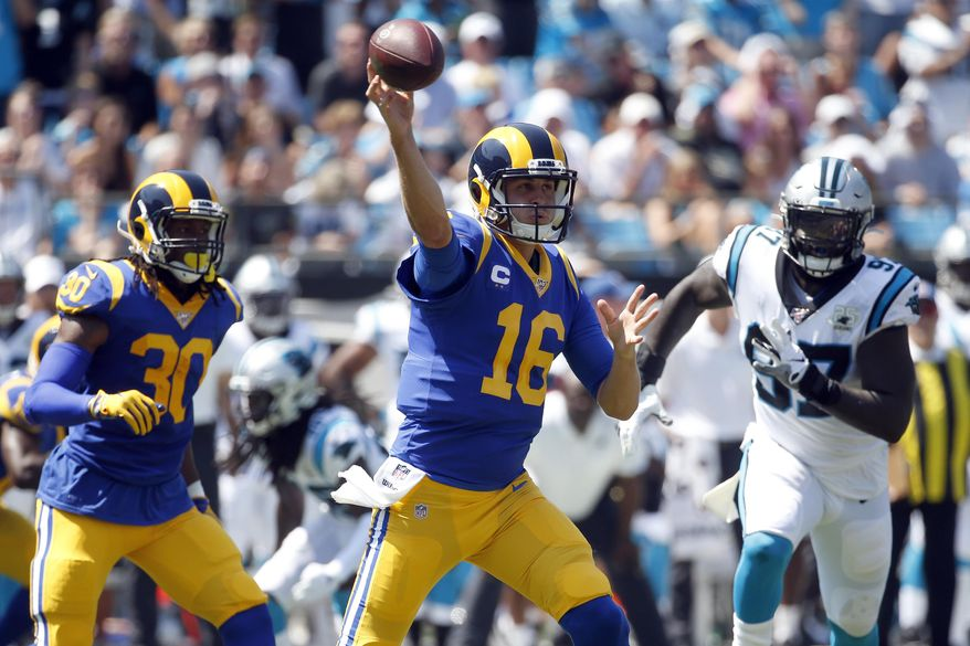 Los Angeles Rams quarterback Jared Goff (16) passes while Carolina Panthers defensive end Mario Addison (97) rushes 4during the first half an NFL football game in Charlotte, N.C., Sunday, Sept. 8, 2019. (AP Photo/Brian Blanco)