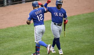 Texas Rangers' Rougned Odor (12) celebrates his home run with Willie Calhoun, right, during the fourth inning of a baseball game against the Baltimore Orioles, Sunday, Sept. 8, 2019, in Baltimore. (AP Photo/Nick Wass)