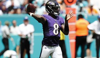 Baltimore Ravens quarterback Lamar Jackson (8) looks to pass, during the first half at an NFL football game against the Miami Dolphins, Sunday, Sept. 8, 2019, in Miami Gardens, Fla. (AP Photo/Brynn Anderson)