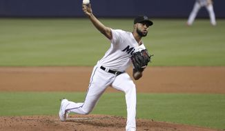 Miami Marlins starting pitcher Sandy Alcantara throws during the second inning of a baseball game against the Kansas City Royals, Sunday, Sept. 8, 2019, in Miami. (AP Photo/Lynne Sladky)