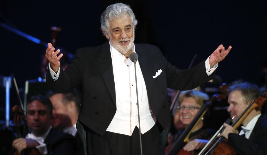 FILE - In this Aug. 28, 2019 file photo, opera star Placido Domingo salutes spectators at the end of a concert in Szeged, Hungary. The union that represents opera performers has launched its own investigation into sexual harassment allegations against Domingo, saying it cannot be sure that opera companies will delve into them sufficiently themselves.The American Guild of Musical Artists said its investigation was prompted by two Associated Press stories in which multiple women accused the opera legend of sexual harassment or other inappropriate conduct. (AP Photo/Laszlo Balogh, File)
