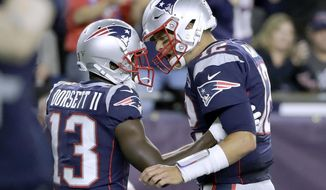 New England Patriots quarterback Tom Brady, right, celebrates his touchdown pass to Phillip Dorsett, left, in the first half an NFL football game against the Pittsburgh Steelers, Sunday, Sept. 8, 2019, in Foxborough, Mass. (AP Photo/Steven Senne)