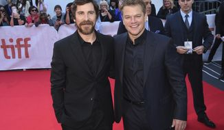 """Christian Bale, left, and Matt Damon attend a premiere for """"Ford v Ferrari"""" on day five of the Toronto International Film Festival at Roy Thomson Hall on Monday, Sept. 9, 2019, in Toronto. (Photo by Evan Agostini/Invision/AP)"""
