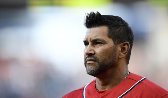 Washington Nationals manager Dave Martinez stands on the field before a baseball game against the Miami Marlins, Saturday, Aug. 31, 2019, in Washington. (AP Photo/Nick Wass)