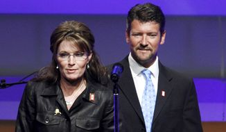 In this June 8, 2009, file photo, Republican Alaska Gov. Sarah Palin and her husband Todd Palin arrive at a Republican congressional fundraiser in Washington.  Court documents appear to show that the husband of former Alaska governor and 2008 Republican vice presidential nominee Sarah Palin is seeking a divorce. The papers, which provide only initials, were filed Friday by T.M.P. against S.L.P. Todd Palin's middle name is Mitchell and Sarah Palin's middle name is Louise. The documents say the couple married Aug. 29, 1988  the same as the Palins. Birthdates for the two also correspond.  (AP Photo/Manuel Balce Ceneta, File)