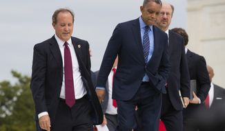 Texas Attorney General Ken Paxton, from left, District of Columbia Attorney General Karl Racine and Alaska Attorney General Kevin Clarkson, walk in front of the U.S. Supreme Court in Washington, Monday, Sept. 9, 2019. A bipartisan coalition of 48 states along with Puerto Rico and the District of Columbia said Monday it is investigating whether Google's search and advertising business is engaged in monopolistic behavior. It follows a Friday announcement of a similar multistate probe targeting Facebook. (AP Photo/Manuel Balce Ceneta)