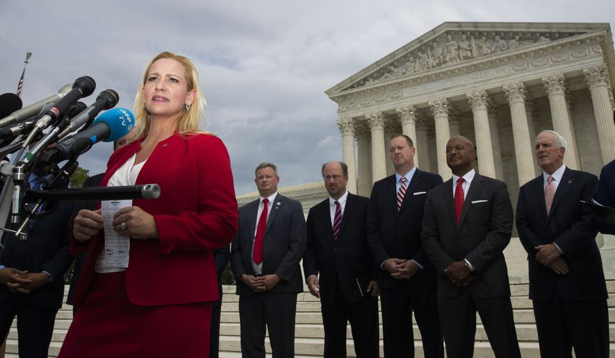 Arkansas Attorney General Leslie Rutledge with a bipartisan group of state attorneys general speaks to reporters in front of the U.S. Supreme Court in Washington, Monday, Sept. 9, 2019. A bipartisan coalition of 48 states along with Puerto Rico and the District of Columbia said Monday it is investigating whether Google's search and advertising business is engaged in monopolistic behavior. It follows a Friday announcement of a similar multistate probe targeting Facebook. (AP Photo/Manuel Balce Ceneta)