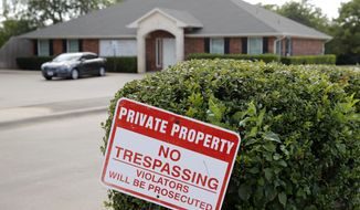 """A """"no trespassing"""" sign sits near the entrance of the parking lot for the Whole Woman's Health clinic in Fort Worth, Texas, Wednesday, Sept. 4, 2019. Faced with drives of four hours or more to Fort Worth, Dallas, El Paso or out-of-state clinics, many women in West Texas and the Panhandle need at least two days to obtain an abortion _ a situation that advocates say exacerbates the challenges of arranging child care, taking time off work and finding lodging. Some end up sleeping in their cars. (AP Photo/Tony Gutierrez)"""