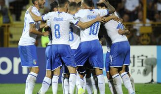 Italy players celebrate after Italy's Andrea Belotti scored his side's opening goal during the Euro 2020 group J qualifying soccer match between Armenia and Italy at the Vazgen Sargsyan Republican stadium in Yerevan, Armenia, Thursday, Sept. 5, 2019. (AP Photo/Hakob Berberyan)