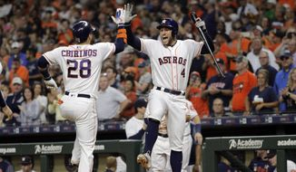 Houston Astros' Robinson Chirinos (28) celebrates with George Springer (4) after hitting a two-run home run against the Oakland Athletics during the first inning of a baseball game Monday, Sept. 9, 2019, in Houston. (AP Photo/David J. Phillip)