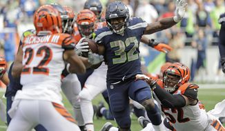 Seattle Seahawks running back Chris Carson (32) rushes against the Cincinnati Bengals during the second half of an NFL football game, Sunday, Sept. 8, 2019, in Seattle. (AP Photo/John Froschauer)