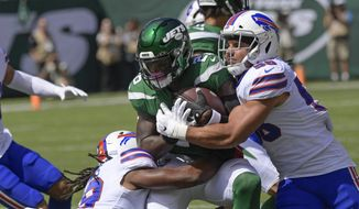 Buffalo Bills' Matt Milano (58) and Tremaine Edmunds (49) tackle New York Jets' Le'Veon Bell (26) tduring the first half of an NFL football game Sunday, Sept. 8, 2019, in East Rutherford, N.J. (AP Photo/Bill Kostroun)