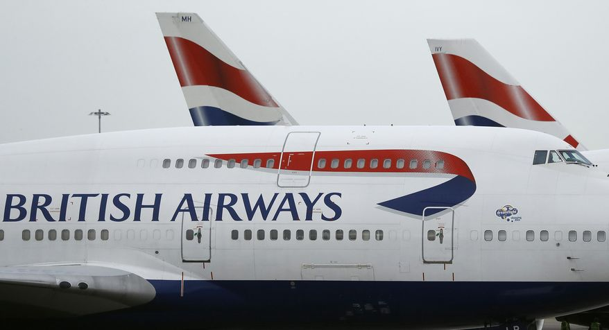 In this Jan. 10, 2017, file photo, British Airways planes are parked at Heathrow Airport in London. British Airways says in a statement Monday, Sept. 9, 2019, it has had to cancel almost all flights as a result of a pilots' 48-hour strike over pay. (AP Photo/Frank Augstein, File)