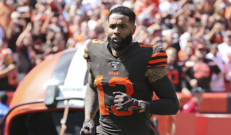 Cleveland Browns wide receiver Odell Beckham Jr. is introduced as he runs out on the field before an NFL football game against the Tennessee Titans, Sunday, Sept. 8, 2019, in Cleveland. The flashy, fashionable wide receiver sported an expensive watch, worth over $250,000, during his debut Sunday. The NFL plans to speak with Browns star Odell Beckham Jr. about wearing a watch in games. (AP Photo/Ron Schwane) ** FILE **