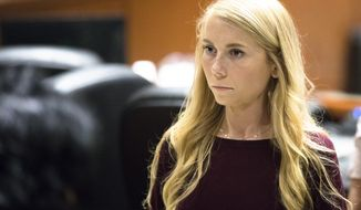 """Brooke """"Skylar"""" Richardson steps out of the courtroom during a recess of proceedings, Friday, Sept. 6, 2019, at Warren County Common Pleas Court in Lebanon, Ohio. Richardson is on trial in the death of her newborn daughter found buried in her family's Ohio backyard.  (Albert Cesare/The Cincinnati Enquirer via AP, Pool)"""