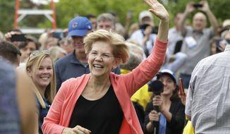 Democratic presidential candidate Sen. Elizabeth Warren, D-Mass., waves as she arrives to a campaign event, Monday, Sept. 2, 2019, in Hampton Falls, N.H. (AP Photo/Elise Amendola)