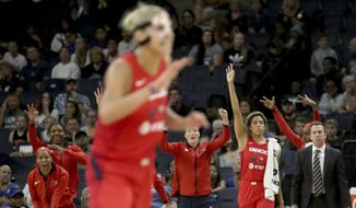 The Washington Mystics' bench celebrates a 3-point basket in the final minute of the team's 86-79 win over the Minnesota Lynx during a WNBA basketball game Friday, Aug. 16, 2019, in Minneapolis. (David Joles/Star Tribune via AP) ** FILE **