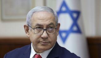 Israeli Prime Minister Benjamin Netanyahu attends the weekly cabinet meeting at his office in Jerusalem, Israel, Sunday, Sept. 8, 2019. (Abir Sultan/Pool Photo via AP)
