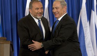 FILE - in this Oct. 25, 2012 file photo, Israeli Prime Minister Benjamin Netanyahu, right, shakes hands with former Defense Minister and Yisrael Beiteinu party leader Avigdor Lieberman in Jerusalem. After forcing an unprecedented second Israeli election of the year by refusing to join the government of his onetime ally, Netanyahu, maverick politician Avigdor Lieberman is now poised to be the kingmaker in the do-over vote on Sept. 17. Neither Netanyahu nor his chief challenger Benny Gantz appears able to form a coalition without Lieberman. (AP Photo/Bernat Armangue, File)