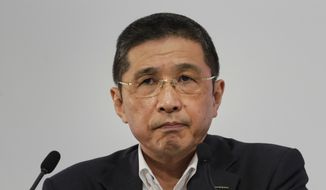 In this July 25, 2019, file photo, Nissan CEO Hiroto Saikawa listens to questions from the media during a news conference at the global headquarters in Yokohama, west of Tokyo. (AP Photo/Jae C. Hong, File)