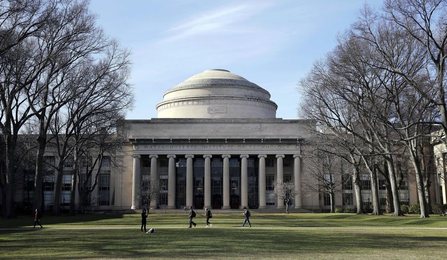 """FILE - In this April 3, 2017 file photo, students walk past the """"Great Dome"""" atop Building 10 on the Massachusetts Institute of Technology campus in Cambridge, Mass. MIT said Media Lab director Joi Ito resigned Saturday, Sept. 7, 2019, after reports he had a more extensive fundraising relationship with disgraced financier Jeffrey Epstein than previously acknowledged. (AP Photo/Charles Krupa, File)"""