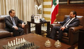 Lebanese Prime Minister Saad Hariri, right, meets with David Schenker, Assistant Secretary of State for Near Eastern Affairs, in Beirut, Lebanon, Monday, Sept. 9, 2019. Hariri received Schenker who will mediate between Lebanon and Israel over a maritime border dispute. (AP Photo/Hussein Malla)