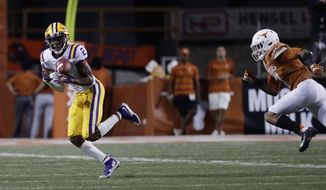 LSU wide receiver Justin Jefferson (2) catches a pass in front of Texas defensive back Caden Sterns (7) and runs for a touchdown during the second half of an NCAA college football game Saturday, Sept. 7, 2019, in Austin, Texas. (AP Photo/Eric Gay)
