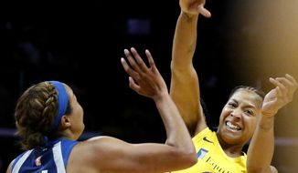 Los Angeles Sparks' Candace Parker, right, passes the ball while defended by Minnesota Lynx's Napheesa Collier during the second half of a WNBA basketball game in Los Angeles, Sunday, Sept. 8, 2019. (AP Photo/Ringo H.W. Chiu)