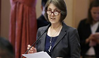 FILE - In this May 30, 2018, file photo, state Sen. Nancy Skinner, D-Berkeley, speaks on the floor of the Senate in Sacramento, Calif. The state Assembly approved Skinner's bill to let college athletes hire agents and be paid for the use of their name, images or likeness. And it would stop the universities and the NCAA from banning athletes that took the money. The bill now goes to the Senate for a final vote. (AP Photo/Rich Pedroncelli, File)