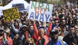 "FILE - In this March 24, 2018, file photo, crowds of people participate in the March for Our Lives rally in support of gun control in San Francisco. The National Rifle Association sued San Francisco on Monday, Sept. 9, 2019, over the city's recent declaration that the gun-rights lobby is a ""domestic terrorist organization."" (AP Photo/Josh Edelson, File)"
